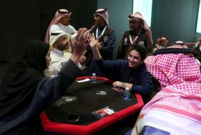 Saudi women play cards with men for the first time!